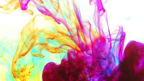 Color liquids slowly mixing. Red, violet, blue, green, orange colors moving. Background theme.