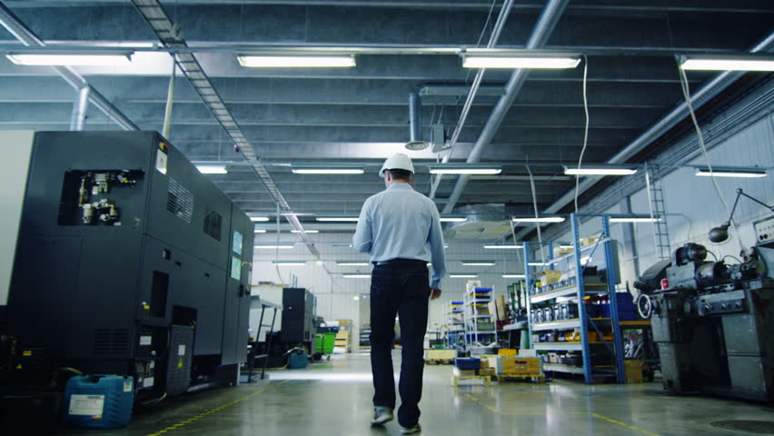 Engineer in Hard Hat is Walking Through Factory. Back View. Shot on RED Cinema Camera in 4K (UHD). | Shutterstock HD Video #11043767
