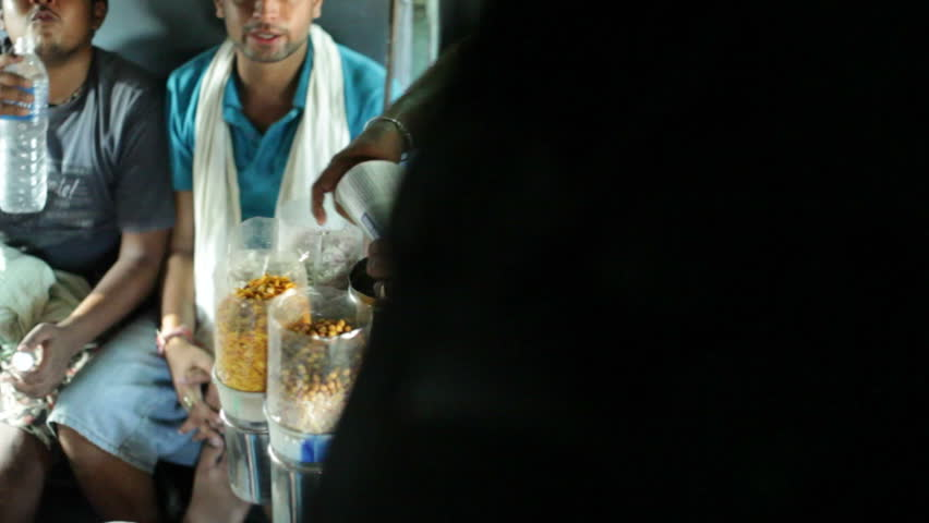 TAMIL NADU, INDIA - CIRCA MAY 2013 - Food snack vendor sells on Indian train, close up, shallow DOF | Shutterstock HD Video #11072642