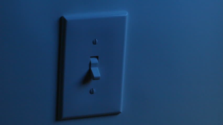 A women's hand flips a light switch on, and then turns it off. Two different backgrounds.