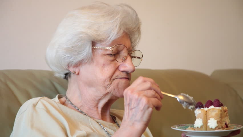 Elderly Woman Eating Tasty Birthday Cake At Home 80 Years Old Grandmother