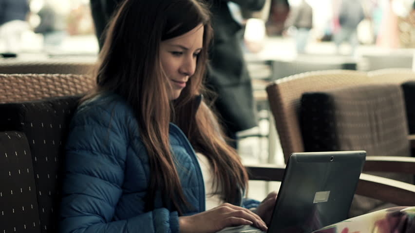Young woman using modern laptop sitting in cafe in city    Shutterstock HD Video #11175908