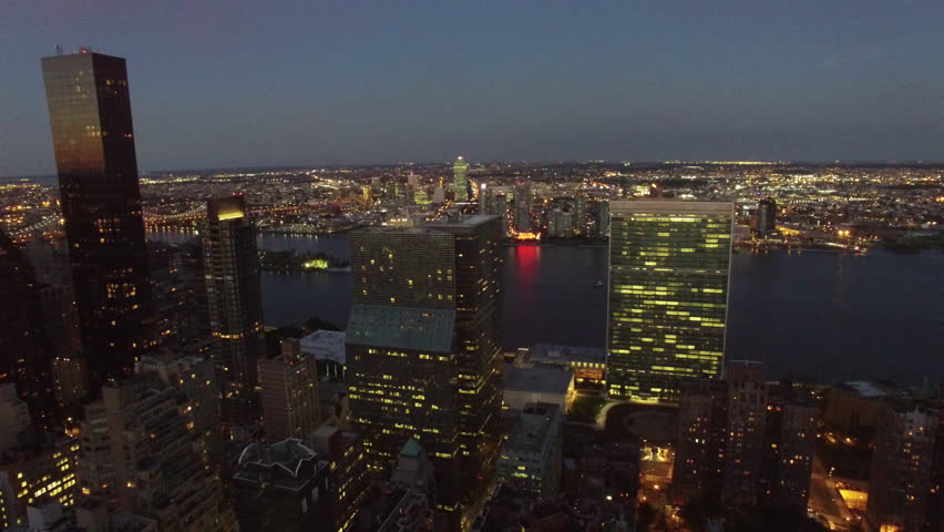 Aerial shots of the United Nations and Chrysler Building and midtown Manhattan at dusk.