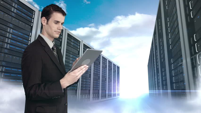 Digital animation of businessman using tablet computer in front of server tower on sky background | Shutterstock HD Video #11246348