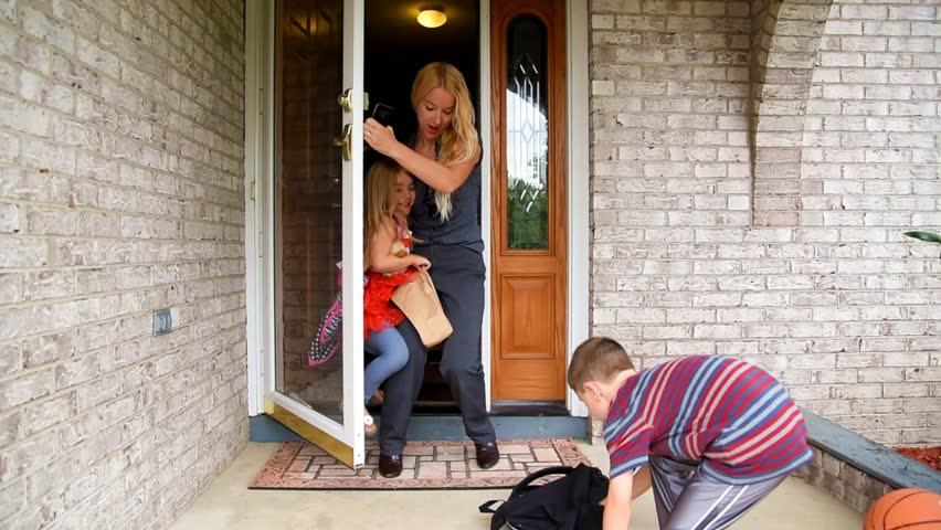 A mother is late for school and work while rushing with her children for a funny stress concept. The children are dropping their book bags and school supplies.