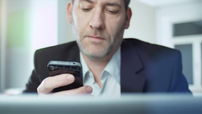 4k - Ultra HD - Businessman using his smart phone - tracking shot (shot on ARRI, 4k Film scan) | Shutterstock HD Video #11283218