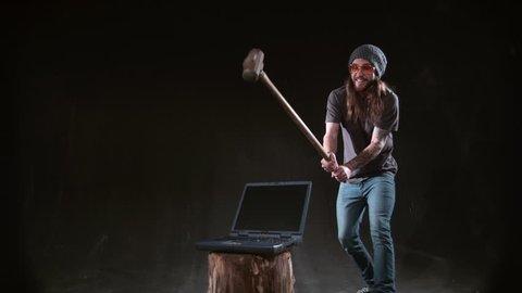 Man smashing laptop with hammer in slow motion, shot on Phantom Flex 4K at 1000 fps