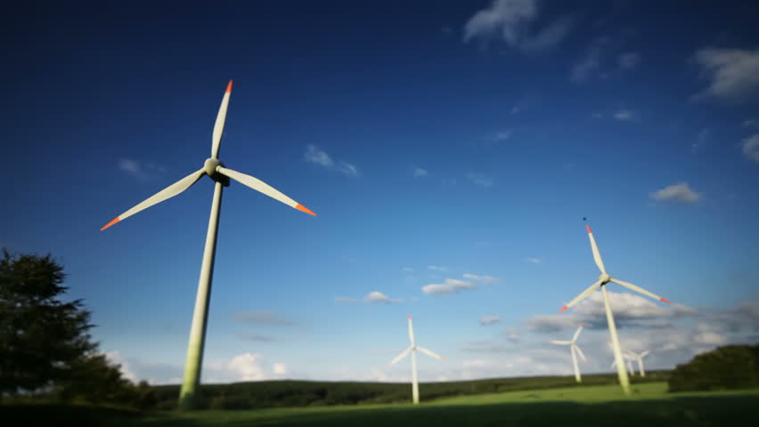 Wind power plants on blue sky background