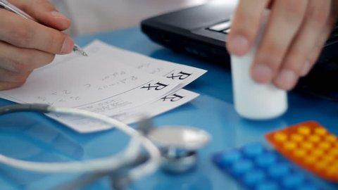 Male doctor writing rx prescription