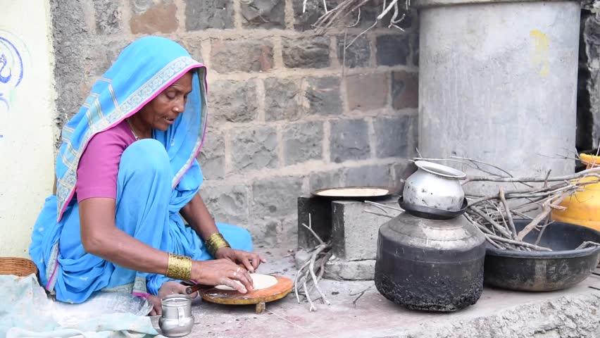 Rural women cooking front of her house, rural village Salunkwadi, Ambajogai, Beed, Maharashtra, India