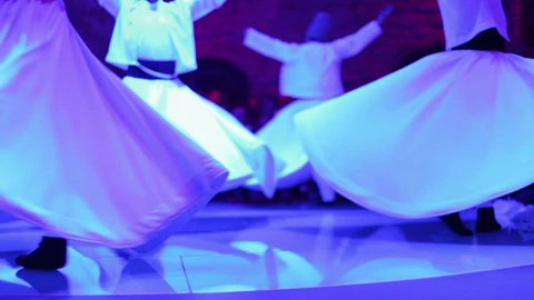 footage shot during a sema ceremony, of sufi dervish dancers