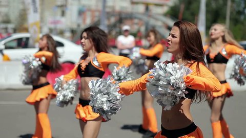 cheerleader dancing outdoors.