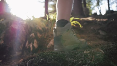 Close up of women legs hiking steep terrain in slow motion