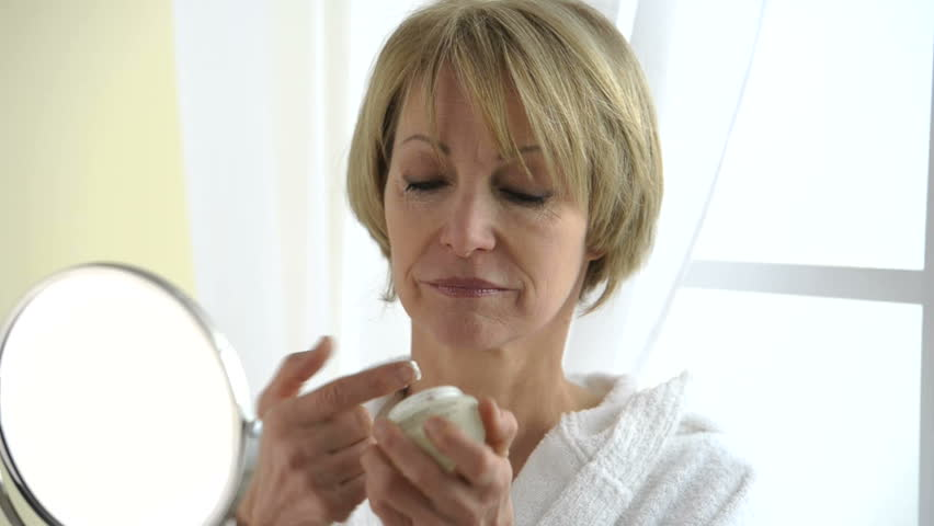 Stock Video Of Beautiful Mature Woman Applying Moisturizer -9271