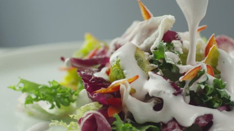 Cook Garnishing Vegetable Salad with Sour Cream. Shot on RED Cinema Camera in 4K (UHD).