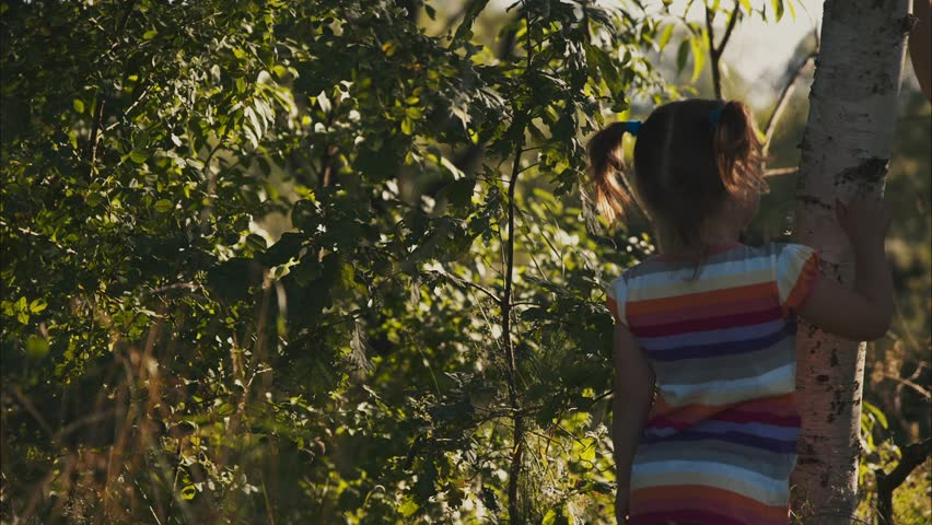 Little girls are cleaning birch bark.  Color correction in Davinci Resolve