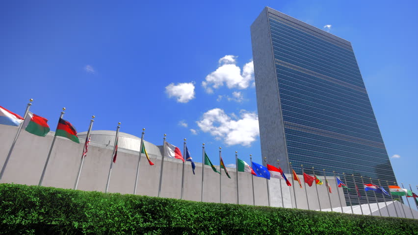 NYC United Nations building, headquarters in New York City and flags of the members countries, panning view  | Shutterstock HD Video #11461745