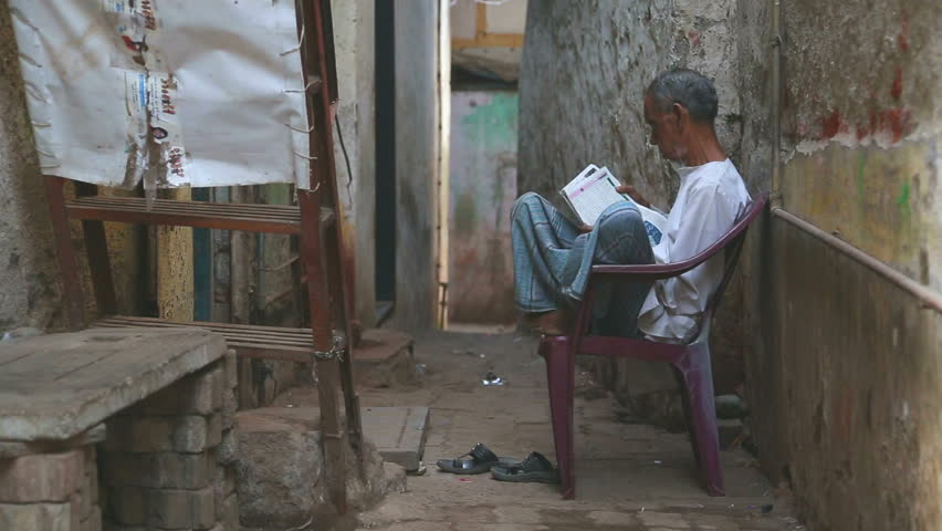 MUMBAI, INDIA - 12 JANUARY 2015: Indian man sitting on a chair and reading newspaper. | Shutterstock HD Video #11478158