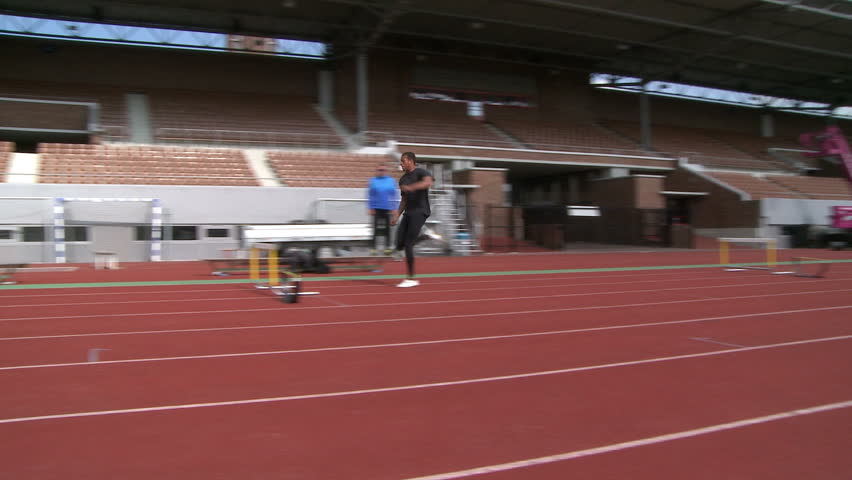 Amsterdam, May 19, 2012. Man on tracks doing hurdle training. #11492699