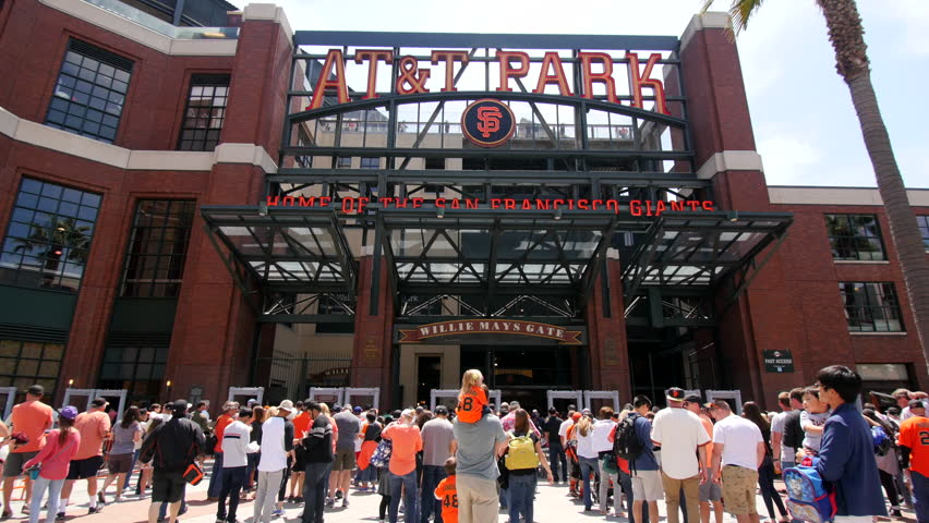 San Francisco - July 2015: Fans lining up at the Willie Mays Gate at AT&T Park-Home of the 2014 World Champions SF Giants-for game day on a sunny summer afternoon wearing orange in fast time-lapse.