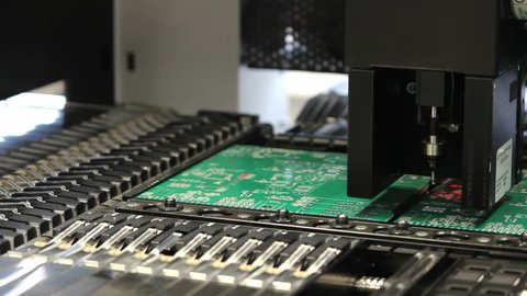 Surface Mount Technology (Smt) Machine places elements on circuit boards