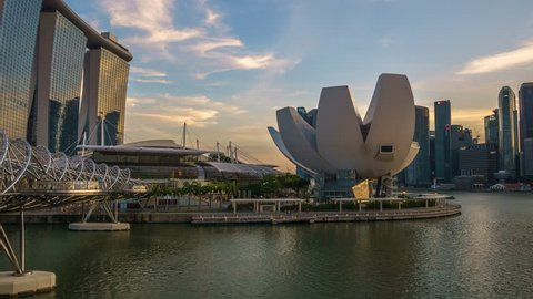 SINGAPORE - August 29: Amazing sunset at Marina Bay Sands in Singapore. Marina Bay Sands is an integrated luxury hotel integrated with shopping mall and casino.  Timelapse Pan Up 2015
