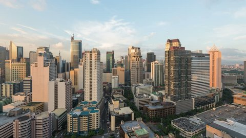 Manila, Philippines - Sept 2, 2015: Metro Manila Day to Night timelapse. Elevated, night view of Makati, one of the most developed business district of Metro Manila.