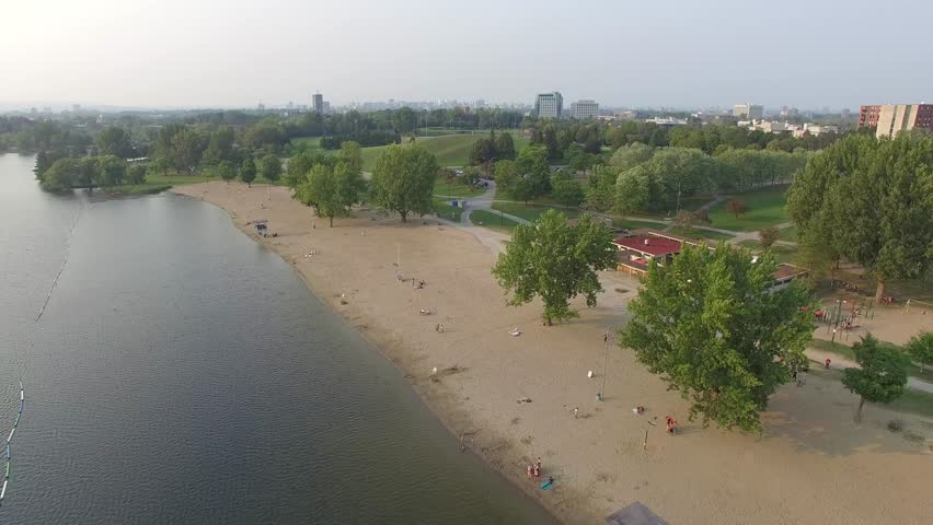 Aerial shot beach with park in background | Shutterstock HD Video #11587748