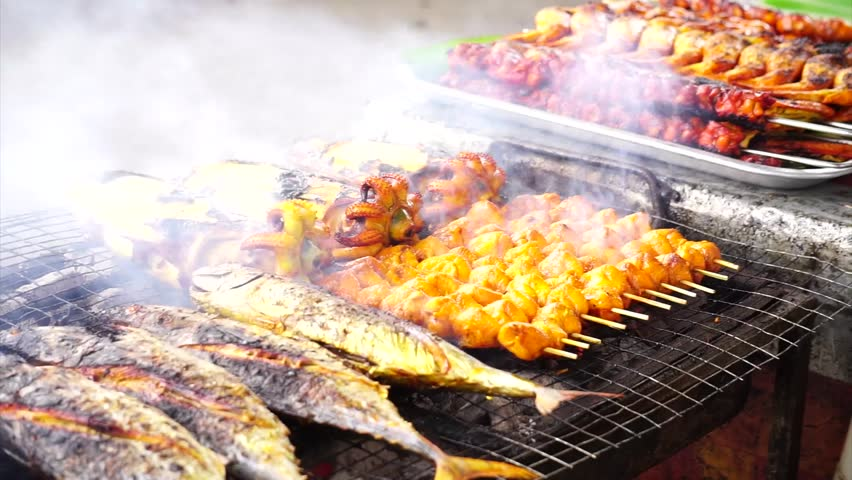 Mixed of chicken, fish and cuttlefish barbecue grilled like satay style.The most popular dish at Sunday market in Borneo Malaysia.