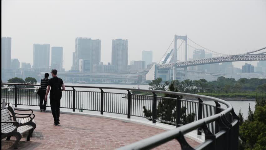 Young confident businessman portrait with manhattan bridge in the rainbow bridge in tokyo bay wide pan 1080p hd voltagebd Gallery