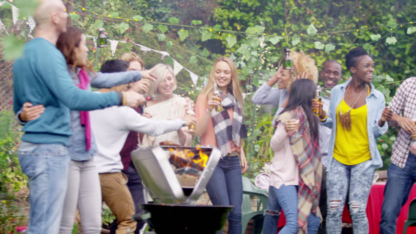 4K Happy Mixed Ethnicity Group Of Friends Raise Beer Bottles For A Toast At Bbq Party