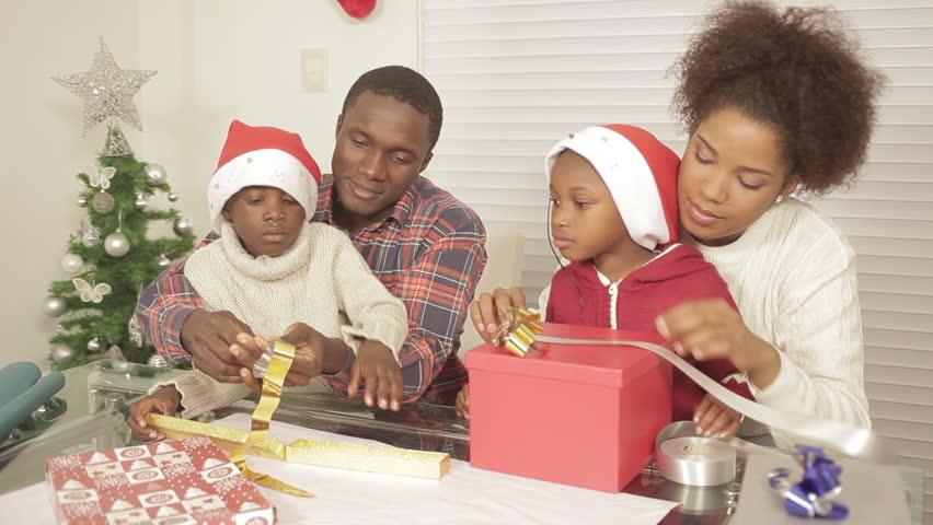 black family assembling christmas gift - Black Family Christmas Pictures
