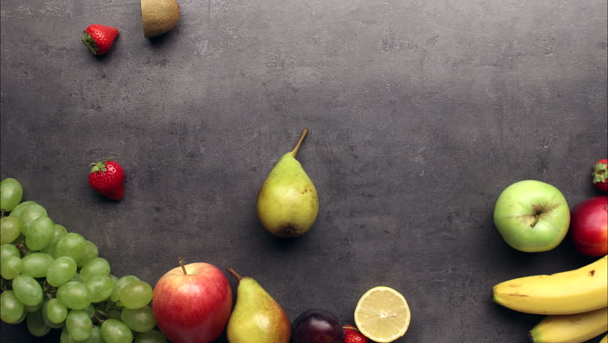 Fresh fruits moving on kitchen table background, stop motion animation, 4K