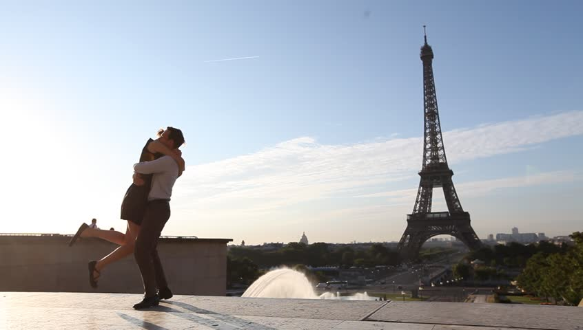 Romantic couple dancing and kissing in front of Eiffel Tower, Paris, France