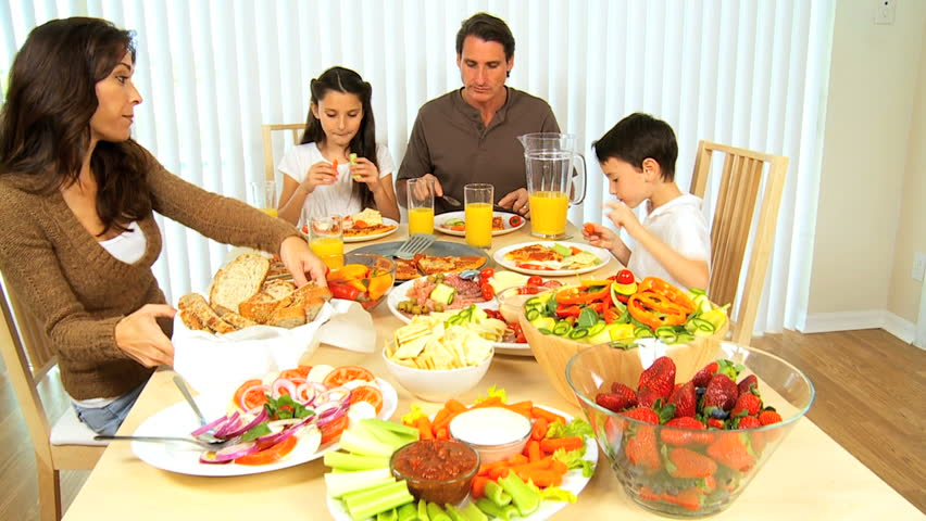 Healthy Young Family Sharing A Nutritious Meal Together ...