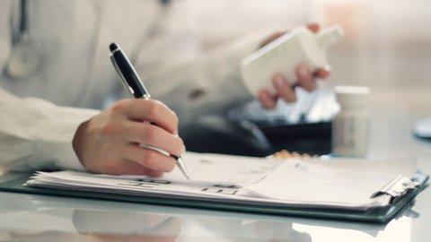 Female doctor hands writing rx prescription