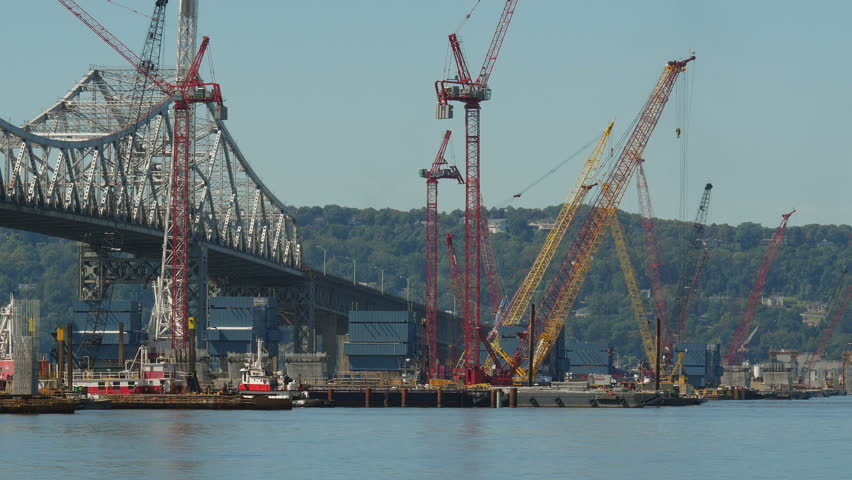 A towboat moves a barge crane into position for work on construction of the New Tappan Zee Bridge over the Hudson River between Westchester and Rockland counties.
