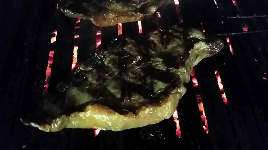 Grilling black angus sirloin steaks, on a coal barbeque #11731448