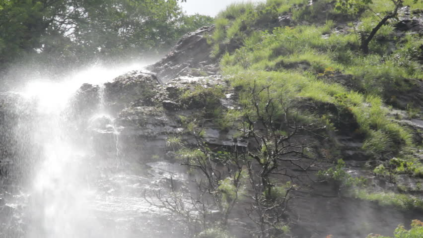 Beautiful Cascading Hivrem Waterfall Producing Mist In The Rain Forest Goa India During