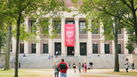 CAMBRIDGE, MA- SEPT 16, 2015: Students gather at Harvard University college campus on September 16, 2015. Harvard University is an Ivy League research university school in Cambridge, Massachusetts.