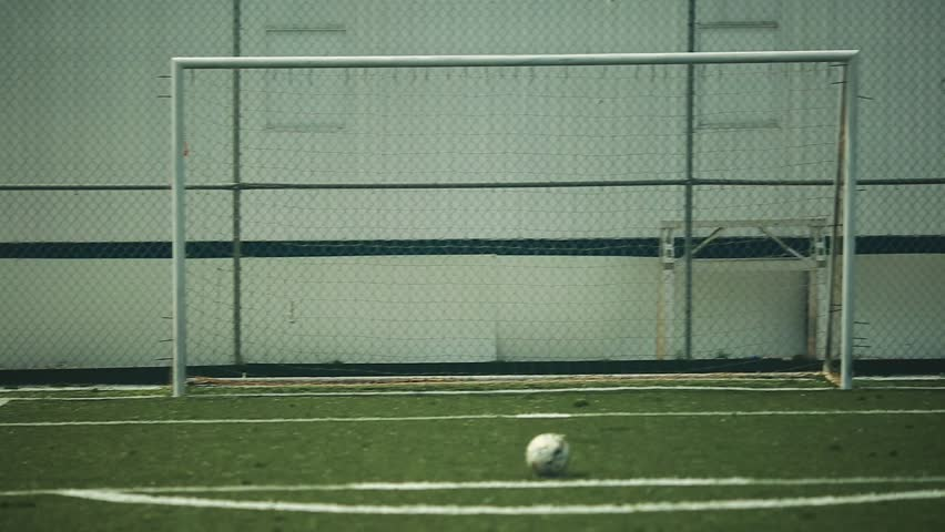 Cool shot of Soccer player practicing kicking ball to net | Shutterstock HD Video #11756468