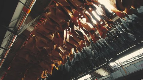 Samples of leather goods on the conveyor hangers