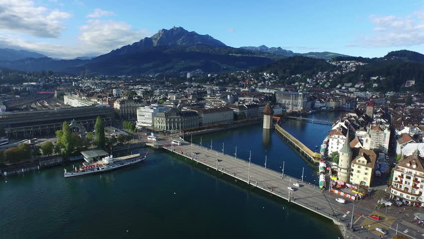 Aerial footage, Old City of Lucerne with Mount Pilatus and water Tower, 4K, UHD