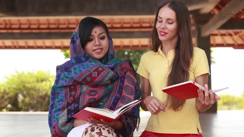European woman volunteering in Nepal, teaching a poor asian woman to speak English language | Shutterstock HD Video #11796167