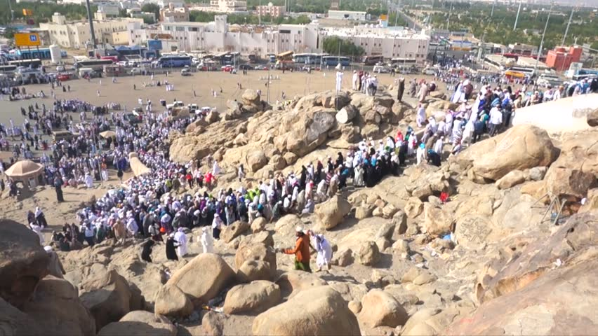 MECCA, SAUDI ARABIA - CIRCA MARCH, 2015: Muslims at Mount Arafat (or Jabal Rahmah). This is the place where Adam and Eve met after being overthrown from heaven.