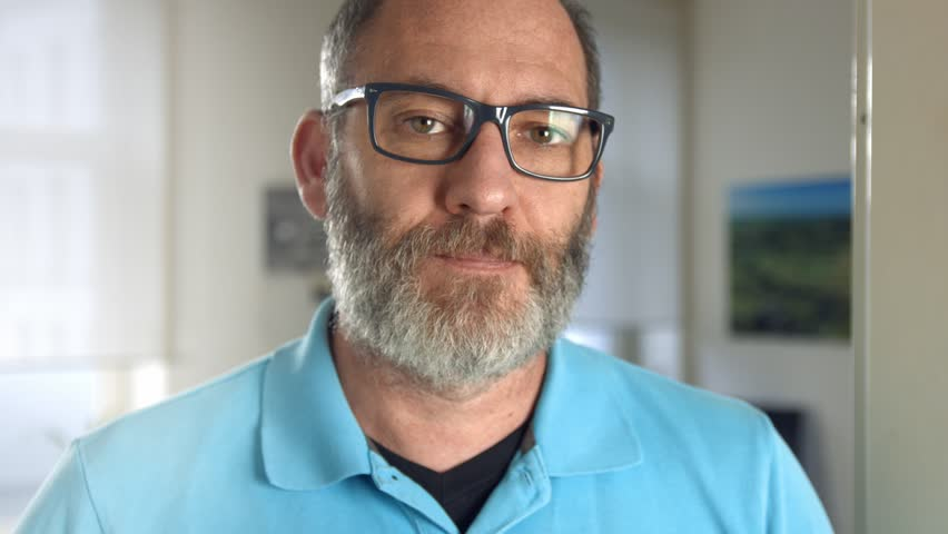 Portrait of a fashionable mature professional creative man with glasses in his office looking into the camera, close up shot | Shutterstock HD Video #11809895