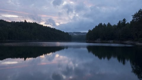 Evening time lapse on Norway lake in Killarney provincial park in Ontario, Canada. Reflection of clouds in the lake.