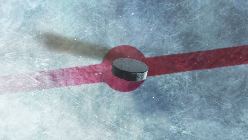 Hockey Puck Drop. animated puck drops from above and hits ice. 3 clips. 1st clip is puck drop on ice. 2nd clip is puck drop on black. 3rd clip is luma matte of puck to isolate it from the background. | Shutterstock HD Video #11834468
