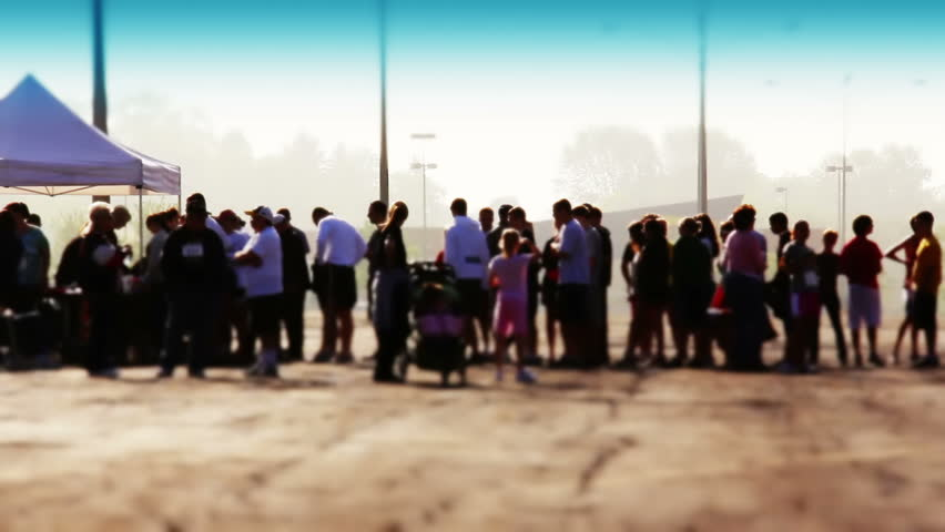People wait in line outside on an early morning to register before a race or