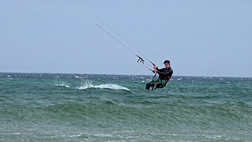 FRASERBURGH, SCOTLAND - SEPTEMBER 25 2015 : Kite surfer enjoys wind and waves at the beach | Shutterstock HD Video #11894738
